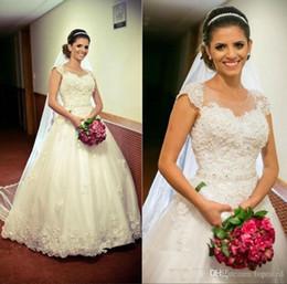 Images Brooch Flowers Australia - Vintage Lace Wedding Dresses Cap Sleeves Applique A Line Illusion Jewel Neck Modest Tulle Sweep Train White Plus Size Bridal Gowns