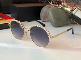 Pearl eyewear online shopping - New luxury women designer sunglasses metal round frame with pearls avant garde charming glasses elegant style UV400 eyewear with box