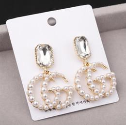 4a9b2e3b5d88 S925 plata aguja personalidad exagerada pendientes de perlas letras de moda  de cristal Japón y Corea del Sur pendientes de Europa y América pendientes