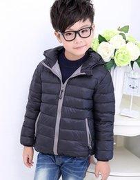 Niños de Down Escudo Diseñador Juniors invierno pato caliente abajo chaquetas El Norte muchachas del muchacho encapuchado Outwear Cara Ligera Casual Top en venta