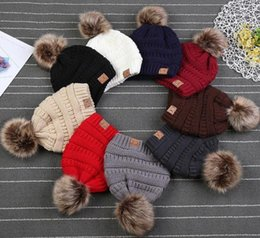 Kids Winter Beanies Australia - Kids CC Trendy Hats Kids Knitted Fur Poms Beanie Winter Luxury Cable Slouchy Skull Caps Fashion Beanie Outdoor Hats 12pcs