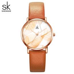 Wholesale Shengke New Women Watches Creative Leaves Dial Bright Leather Strap Quartz Clock Fashion Casul Ladies Wristwatch Montre Femme