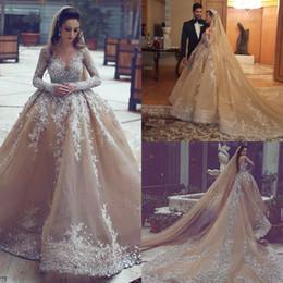 $enCountryForm.capitalKeyWord Australia - Dubai Arabic Champagne Ball Gown Wedding Dresses Luxury Sparkly Long Sleeve Bling Beaded Lace Applique Long Train Bridal Gowns Sexy Backless