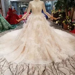 Train works online shopping - Luxury Special Wedding Dresses With Feather O Neck Long Tulle Sleeve Beaded Crystal D Flower Wedding Gown With Long Train Hand Working