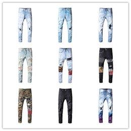 Venta al por mayor de Diseñador de moda para hombre 2019 pantalones vaqueros negros camuflaje pantalones vaqueros pitillo rotos Leopard patchwork pantalones para hombre diseñador remache pantalones vaqueros de motocicleta D30