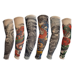 $enCountryForm.capitalKeyWord NZ - Nylon Elastic Tattoo Cover Arm Sleeve Skull Dragon Snake Flower Fish Designs Sunscreen Sleeves Breathable Cycling Unisex Stretchable Tattoos