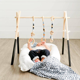 baby accessories clothes toys Canada - Nordic Baby Room Decor Play Gym Toy Wooden Nursery Sensory Toy Gift Infant Room Clothes Rack Accessories Photography Props Y200111