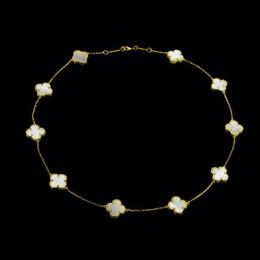 0458115cfc8c Nueva joyería de la flor del trébol de cuatro hojas para las mujeres collar  corto choker negro verde rojo cáscara de la perla collares Dropshipping