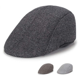 c82eeac1d5c782 Casual men's hat autumn and winter tide warm ear protection fashion beret  thick fashion plaid stripes Berets