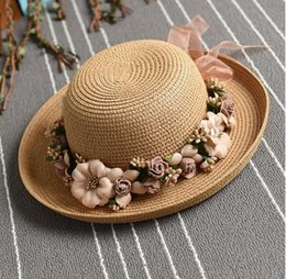 wholesale faux fur cuffs NZ - 2019 new hot sale leisure holiday wreath sunshade fisherman beach sun hat handmade cuffed flowers straw hat ladies summer tide