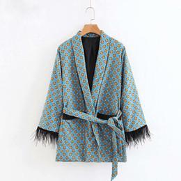 Venta al por mayor de Chaqueta de moda Las mujeres suelta Kimono Escudo Bow Tie Fajas Bolsillos Borla Decorar Prendas de abrigo Oversized Ladies Autumn