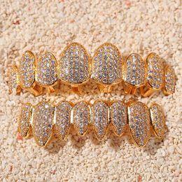14k Oro CZ Vampire Dientes Grillz Iced Out Micro Pave Cubic Zircon 8 Dientes Hip Hop Parrilla Parte superior de la parte superior de los dientes Grillz Conjunto con la barra de moldeo de silicona en venta