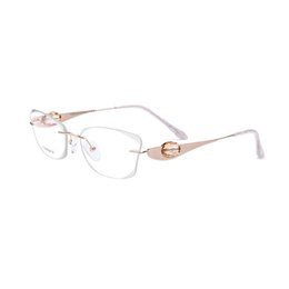 17 gold NZ - Titanium Gold Women Eyeglasses With Crystal Diamond Clear Lens Glasses The Lenses Can Be Replaced Size 54-17-135mm T200323