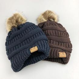 a494041e6cc Girls Boys CC Pom Pom Beanies Children Knitted Hats Warm Kids CC Label  Beanies with Ball Unisex Casual Winter Cap Outdoor Crochet Hat