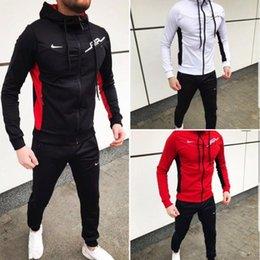 Venta al por mayor de Nuevos y nuevos 2019 Hombres Diseñadores Chándales Marcas de otoño Chándales para hombre Jogger Trajes Chaqueta + Pantalones Conjuntos Traje deportivo