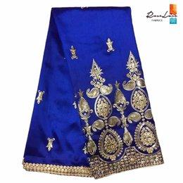 Hot Royal Blue George Lace Fabric 2018 Design Gold Sequined Embroidered  Silk George Tissu Indian Wedding Dress Guipure Fabrics 5eafbc38da26