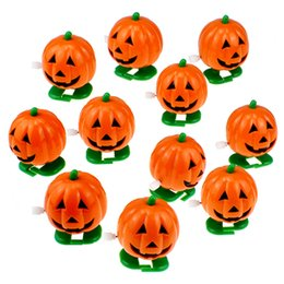 free boy toy Australia - 150PCSdhl free shipping wholesale New Cute pumpkin Halloween Clockwork Direction Toys Bounce Toys Jump Pumpkin Monster Boys