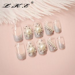 Discount pre design false nails glue LKE 24PCS Set Full Nail Tips Artificial False Nails White Pearl Nail Stickers for Wedding or Party With Glue Pre Designe