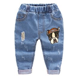 boys fashion red trousers Canada - 2018 Fashion Children Jeans Baby Boys Cartoon Trousers Pant Baby Girls Grinding Holes Jeans Kids Spring Autumn Clothes 2-6years Y19051504
