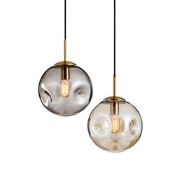 China Postmodern creative personality glass concave ball pendant lights loft parlor bedroom restaurant bar art decor lighting cheap concave glass suppliers