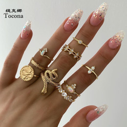 $enCountryForm.capitalKeyWord Australia - Tocona New Fashion Luxurious Gold Color Finger Rings Sets Hollow Round Geometric Hard Crystal Stone Snake Jewelry For Women 7054
