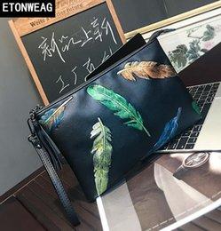 $enCountryForm.capitalKeyWord NZ - Factory direct brand men bag street trend color leaf printing hand grip bags new printed leather envelope bag fashion slung shoulder bag
