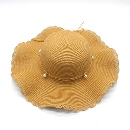 $enCountryForm.capitalKeyWord UK - Fashionable High Quality Large Eaves Braided Straw Hat for Ladies Beach Hat Sun Protection Hat Pearl Bow Style