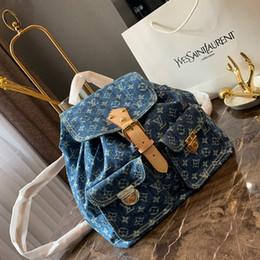 8895256a7 Calidad superior de lujo para mujer mochila bolsos de diseño mochila de  mezclilla estilo de alta capacidad de moda bolsas 20 * 30 cm L190429-3
