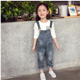 suspender overall denim jumpsuit NZ - Baby Girls Overalls Autumn Denim Jumpsuit Style Long Jeans Casual Washed Rompers Pocket Button Suspender Trousers Children Girl Jeans new