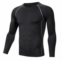 Venta al por mayor de Medias deportivas Nueva ropa de entrenamiento para hombres Ropa de fitness para hombres Camiseta transpirable de manga larga para hombres Corsé elástico Absorbente de humedad