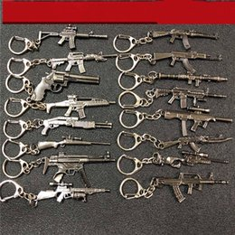 $enCountryForm.capitalKeyWord Australia - New Game 6cm Mini Gun Keychain Metal Key Ring Chain Souvenir Men Car Women Bag Jewelry
