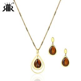 d1a7534bd493 Conjunto de joyas ovaladas con ojo de tigre de oro de RIR Conjunto de  piedras naturales Collar de gota de agua bohemio y pendientes colgantes  Piedra marrón