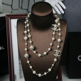 Chinese  Brand Luxury Designer New Pearl Chain Hot Selling Classic Pearl Full Diamond Planet Long Sweater Chain 001 manufacturers