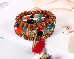 $enCountryForm.capitalKeyWord NZ - 4pcs Lot Boho Wooden beaded Chains Bracelets For women Elephant Tassel Feather charm Wood crystal Beads Bangle Bohemian Jewelry