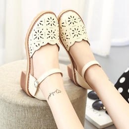 Koreans new sandals online shopping - Sandals female summer Korean version of the new wild with a word buckle round head hollow breathable women s shoes