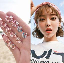 $enCountryForm.capitalKeyWord Australia - New small fresh Korean flower wreath earrings female temperament simple wreath petal earrings