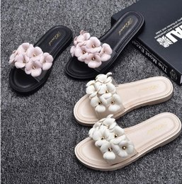 eae2f55a5 Free shipping Camellia jelly slippers female summer waterproof flowers plastic  sandals beach shoes crystal sandals female flat word