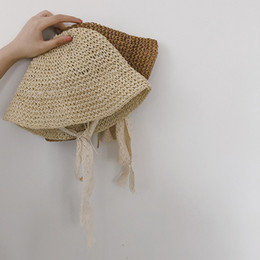 BaBy Boy straw summer hat online shopping - new Spring and Summer Children Straw Hats Lace Straps Baby Girls Beach Sunshade Caps Vacation Kids Weave Hat can be adjustable T191014