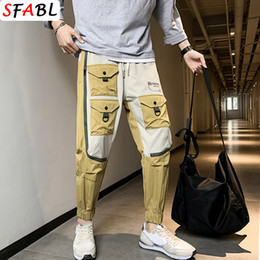 Wholesale young men fashion pants resale online - SFABL Young Fashion Multi Pockets Men s Streetwear Cargo Harem Pants Hip Hop Male Casual Cotton Pants Joggers Trousers Men