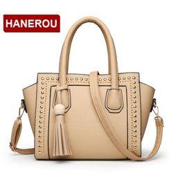 Suede Ladies Handbags NZ - Litchi Paern Women PU Leather Handbags Rivet Shoulder Bags For Woman Nice Trapeze Handbag Tassel Bag Lady Small Tote Bags