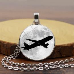 Titanium Moon Pendant Australia - New creative airplane moon pattern pendant necklace convex round glass pendant fashion accessories simple and delicate accessories wholesale