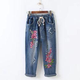 c7faafc23 Primavera Mulheres Jeans Solta Lace Up Harem Pants Calças Elásticas Denim  Bordado Flores Calças Do Vintage