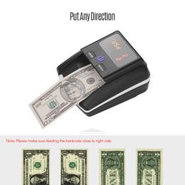 Macchina portatile del tester di contanti di valuta del rivelatore di falsi UV / MG / IR / DD del rivelatore di banconota della piccola banconota in Offerta