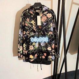 $enCountryForm.capitalKeyWord NZ - High end women girls coat long sleeves Hem drawstring bag hip Fashion floral printing Long sleeve hooded windbreaker jacket tops coat