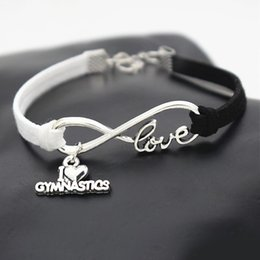 gymnastic charms NZ - Bohemia Infinity Love Gymnastics Sports Pendant Charm Bracelets For Women Men Handmade Weave White Black Leather Suede Rope Pulseras Jewelry