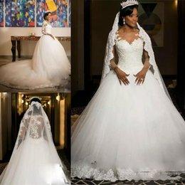 Vestido de fiesta africano Vestidos de novia de encaje Apliques vintage Ilusión Mangas largas Tallas grandes Vestidos de novia Catedral Tren Tul vestido de novia en venta