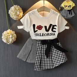 Vente en gros 33 styles Tenues enfant T-shirt + jupes pantalons courts 2pcs Set de vêtements pour enfants de mode pour filles INS définit 2019 nouveaux enfants