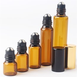 Wholesale Essential Oil Glass bottles ml ml ml ml ml vegetable oil Essence Storing Aromatherapy black Cap Perfume Amber Vial