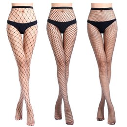 5ed4bd261f433 2019 Hollow out sexy pantyhose female Mesh black White women tights  stocking slim big fishnet stockings club party hosiery