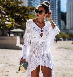 Womens Skirted Jacket Australia - New openwork knit skirt trumpet sleeve beach jacket sexy bikini blouse sunscreen clothing swimsuit womens bikinis cover-ups knitted free